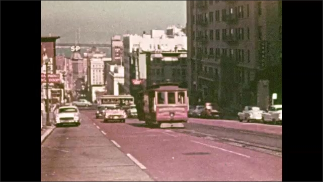 1950s: Steam train travels across landscape. Cars and trolley drive on streets. Man talks to little girl, man in silly costume interrupts.