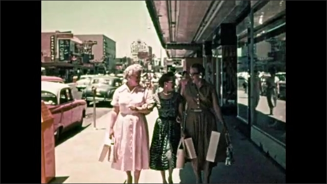 1950s: Man stand outside, children play on playground, people sit on ground, play game, laugh, women walk down sidewalk, family walks down sidewalk, people speak with gondolier.