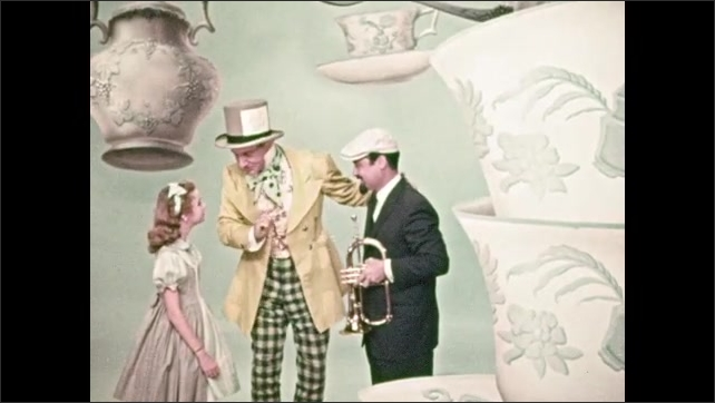 1950s: Mad Hatter talks animatedly, smiles, young girl listens. Mad Hatter shakes hand of man with trumpet, introduces him to girl, talks sternly.