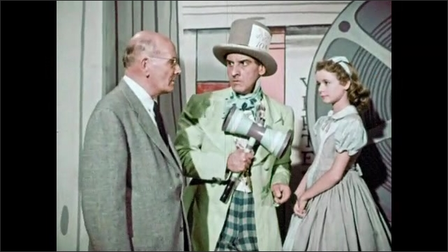 1950s: Animated letters dance and run away, Mad Hatter holding mallet speaks to little girl. Man in suit arrives to talk.