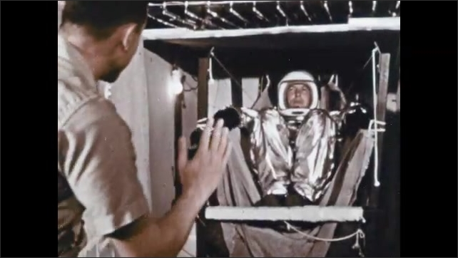1960s: UNITED STATES: man in astronaut suit. Man climbs into cabin. Centrifuge testing