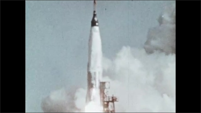1960s: UNITED STATES: Project Mercury testing. Space rocket takes off. Man with headset