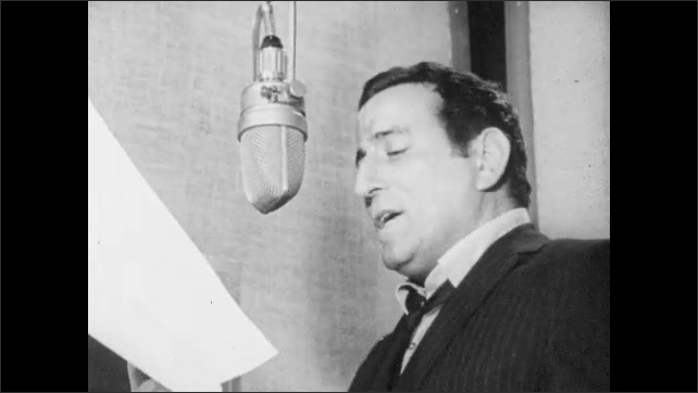1960s: Vocalist sings into microphone and reads music. Tony Bennett sings into microphone in recording booth. Man sings and bounces to music.
