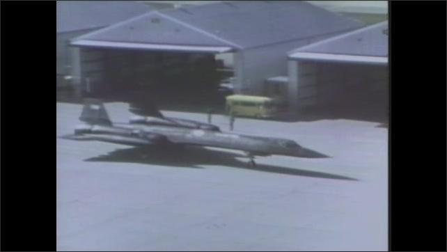 1970s: UNITED STATES: plane outside hanger. Blackbird plane. Titanium planes