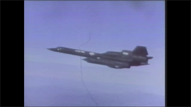 1970s: UNITED STATES: plane flies in sky. Blue sky and clear day. Blackbird plane in flight.
