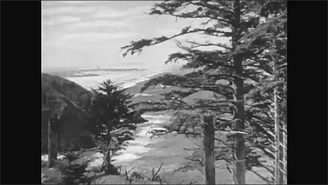 1950s: Small island in middle of lake. People ride horses and fish near lake. Waves crash onto rocky shores. Seals climb over rocks, jump into water.