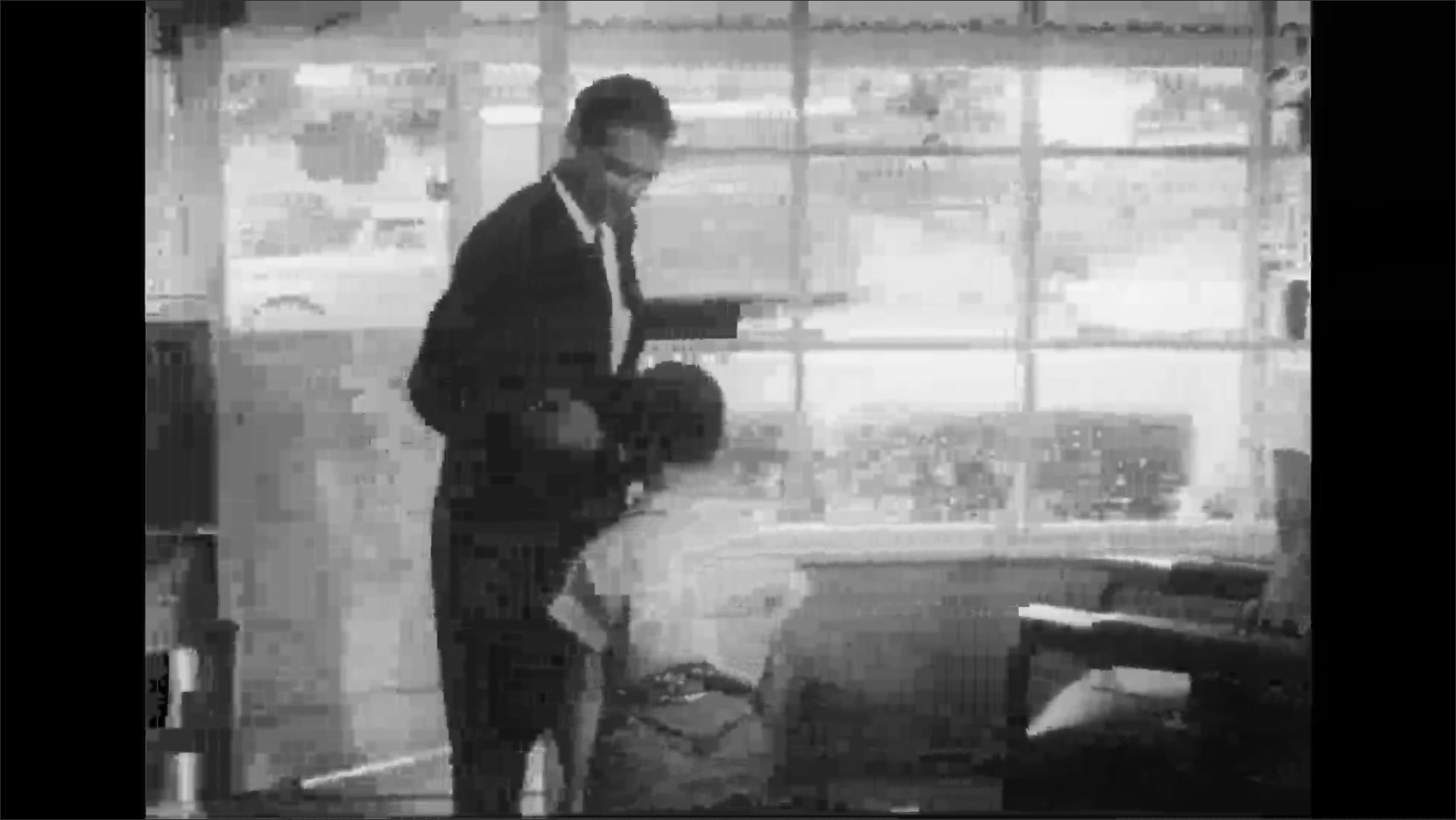 UNITED STATES 1950s: Man pays barber, takes son from shop / Man and boy exit barber shop.