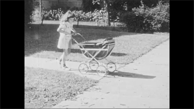 1950s: Father shoos little girl away because she is a girl. Little girl pushes her doll carriage down sidewalk.