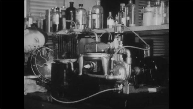 1940s: UNITED STATES: carbon scientist in laboratory at anti-freeze plant. Radiator cooling fluid and froth production experiment.