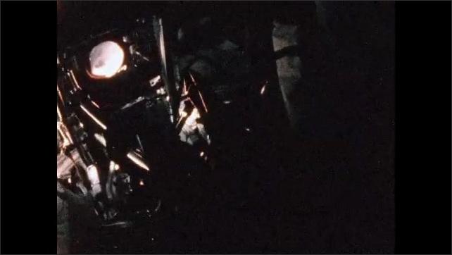 1970s: Astronaut in spacecraft.