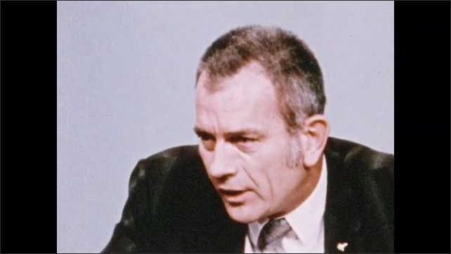 1970s: Man speaks at press conference.