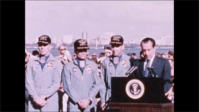 1970s: Astronauts sit in robes, listen on phone. Astronauts stand by as President Nixon speaks.