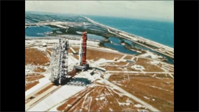 1970s: UNITED STATES: Spacecraft on gantry. Overhead and side view of rocket on launch pad.