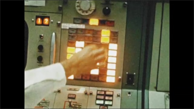 1970s: UNITED STATES: ground support watch computer monitor. Flight controllers prepare rocket for third stage. Man in chair.