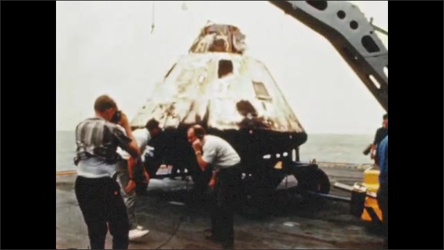 1970s: UNITED STATES: command module on deck of ship 8 hours after launch.