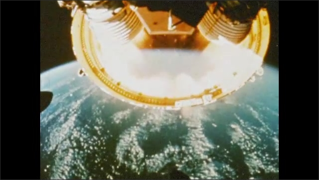 1970s: UNITED STATES: first stage detaches from rocket. View of Earth below as stage falls into space.