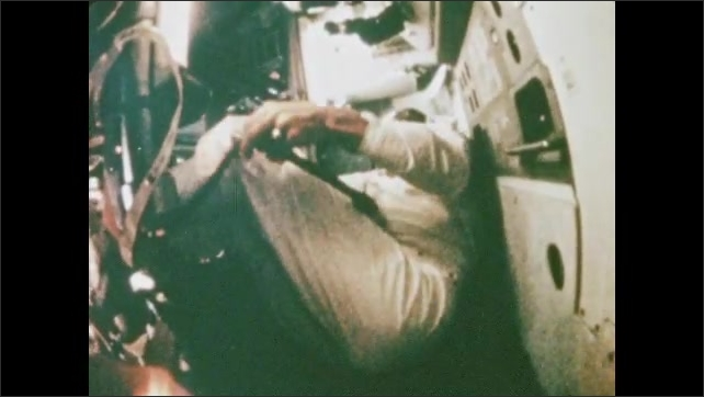1970s: UNITED STATES: astronaut controls Apollo 8 during flight. Flight controllers at mission control.