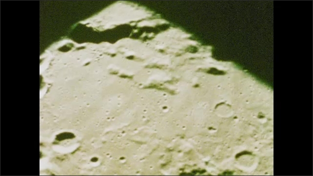 1970s: UNITED STATES: craters on surface of the moon. Faster rate footage of moon surface. 60 miles above the moon's surface.