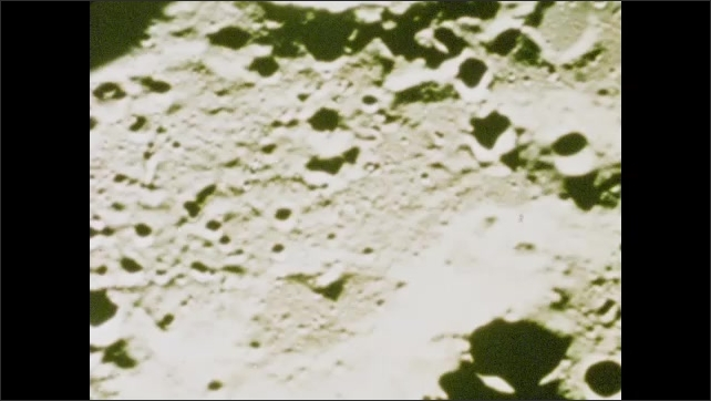 1970s: UNITED STATES: video footage of craters on surface of moon.