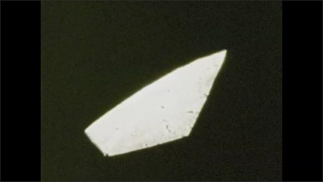 1970s: UNITED STATES: view of moon through Apollo 8 window.