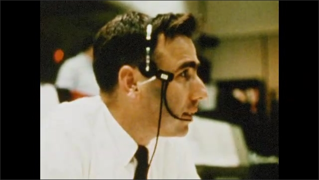 1970s: UNITED STATES: men smile at mission control in Houston. Period of relaxed vigilance at Houston mission control centre