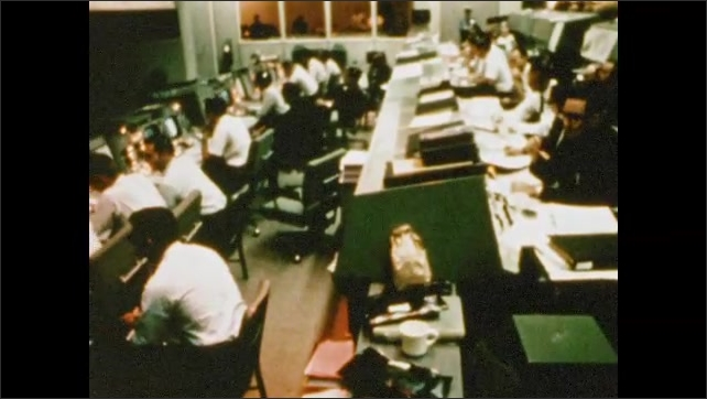1970s: UNITED STATES: mission control Houston wait for communication blackout to end on Apollo 8. Flight controller puts in call to Apollo 8.
