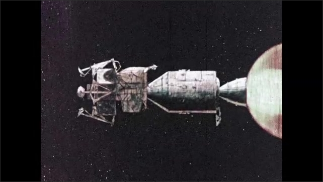 1960s: Communications satellite moves. Boosters fire, spacecraft moves through space.