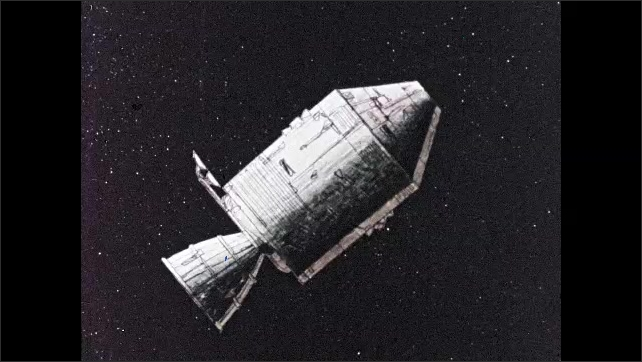1960s: Spacecraft floats in space. Capsule detaches from spacecraft.
