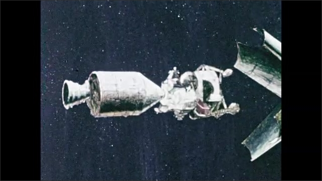 1960s: Command module docks with lunar module in spacecraft, separates from spacecraft. Thrusters fire at back on spacecraft.