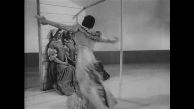 1950s: Woman dances seated next to woman standing. Woman stands and dances. Woman dances as four women sit still and two men stand still in poses.