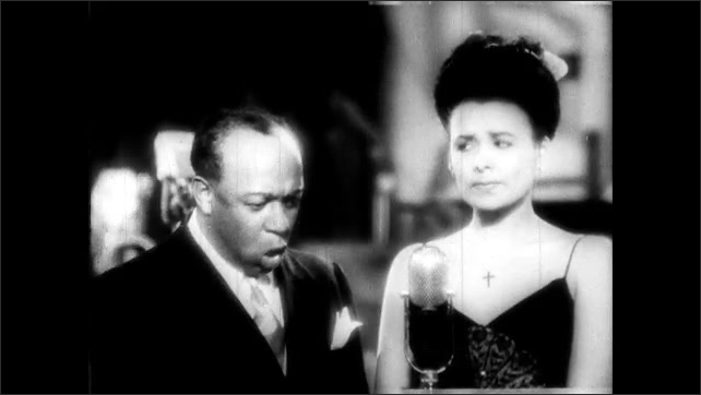 "1940s: Lena Horne sings and flirts on stage with Eddie ""Rochester"" Anderson. Eddie Anderson and Lena Horne sing ""Consequences""."