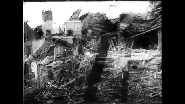 1940s: Ruins of church. Ruins of building. Men dig through rubble.