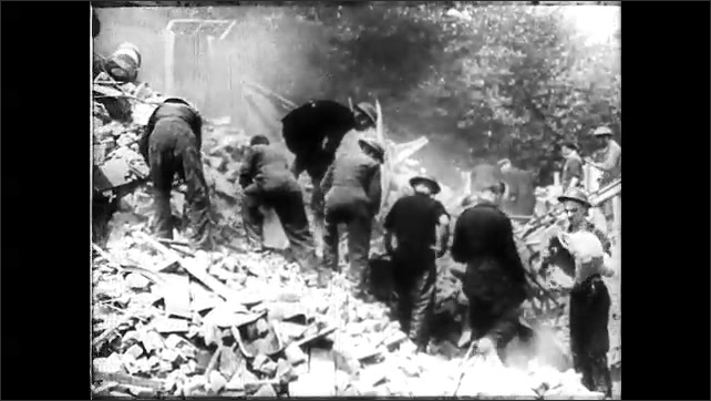 1940s: Men carry stretcher away from rubble. Men excavate rubble. Doctor checks pulse of patient. Doctor stands by patient's bed.
