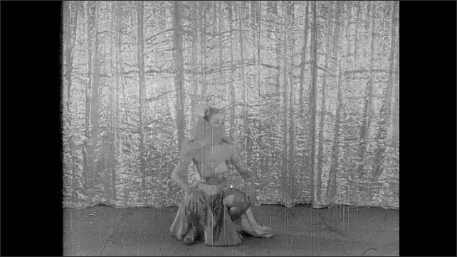 1950s: Woman in veil dancing, woman removes pants.