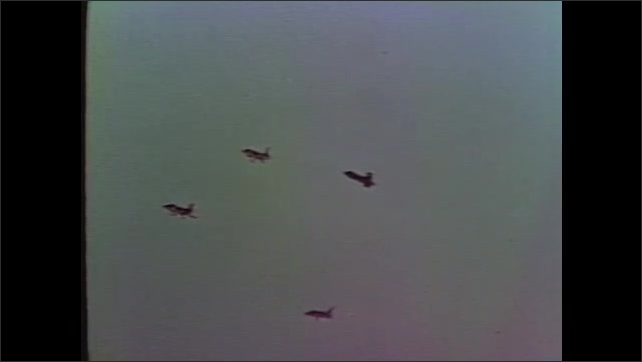 1960s: Planes fly through sky.  Animated plane drawing rotates.