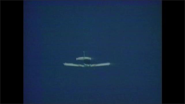 1960s: Airplane flies.  Plane spins.  Water.