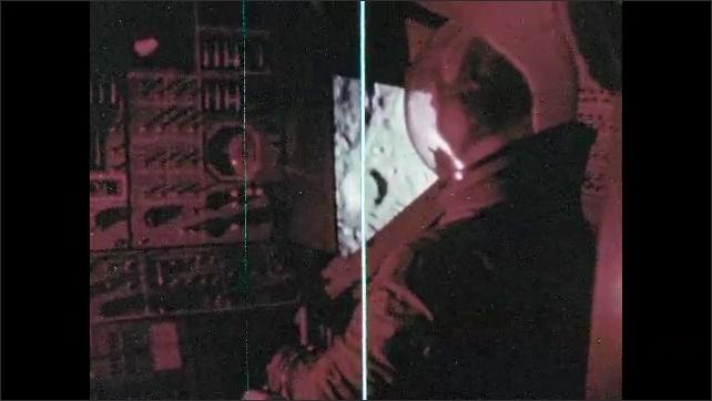1960s: Astronaut in spacecraft.