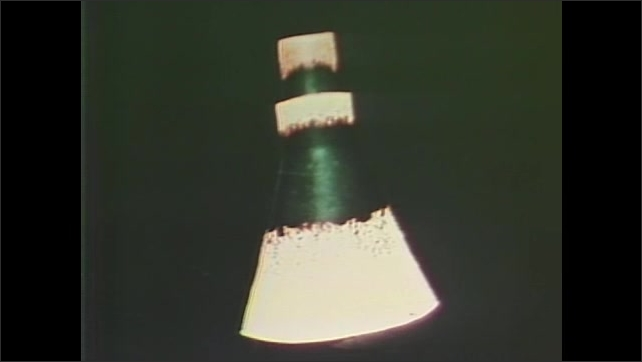 1960s: UNITED STATES: animation of capsule in space. Heat shield on capsule. Patrol aircrafts in sky