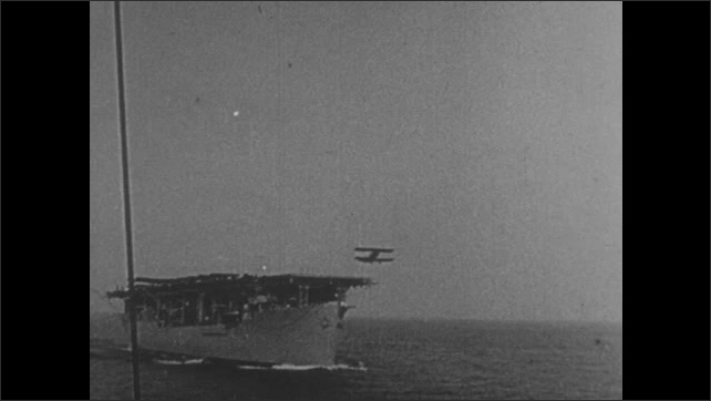1950s: Battleship fires rockets. Clipper on dry land. Biplane takes off from early aircraft carrier. Modern aircraft carrier.