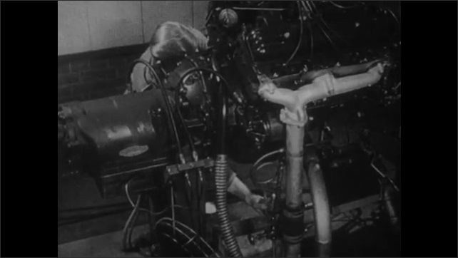 1950s: UNITED STATES: man takes sample of oil from engine. Radioactive particles counted in oil sample. Geiger counter used to measure radioactivity of oil