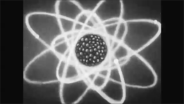 1950s: UNITED STATES: explosion of energy. Cartoon of Einstein and equation for energy. Particle splits uranium atom.