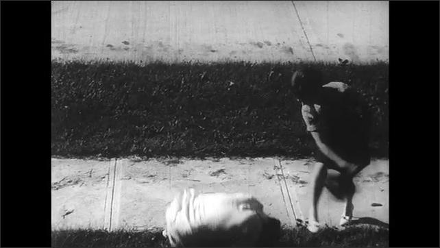 UNITED STATES 1960s: close up womans legs walking/ woman walking/ man comes up behind woman/ man assults woman/ woman attacks man with handbag/ man lying on floor/ woman walking/ man attacks woman