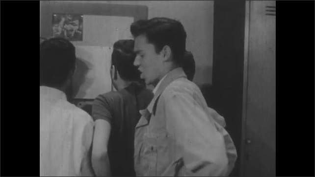 1950s: Locker room, teenage boy walks over to group of boys looking closely at paper posted on bulletin board, talks, group turns around. Neighborhood, boy sighs, runs hand through hair.