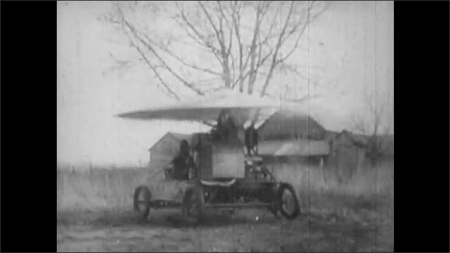 1930s: Sky Car bucks and hops on the ground under large rotor. Experimental windmill rotor airship turns its rotor.