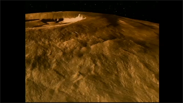 1990s: UNITED STATES: topographical modelling of planet surface. Crater on surface.