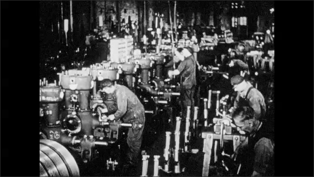 1940s: Welder at work. Man looking into microscope. Man drafting designs at table. Man at work on machines in factory. Machine working.