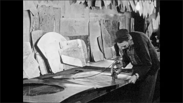 1940s: Man installs vent cover in base of wall. Man cutting sheet metal. Man cuts sheet metal. Teacher in front of engineering class.