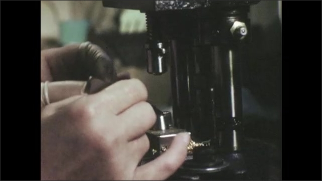 1960s: UNITED STATES: hands do manual work with small objects. Close up of lady's face. Hands work machines. Hands tie off rope. Knife cuts thread