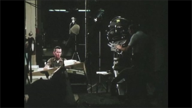 1960s: UNITED STATES: film crew in studio. Actors in make up. Man in wheelchair