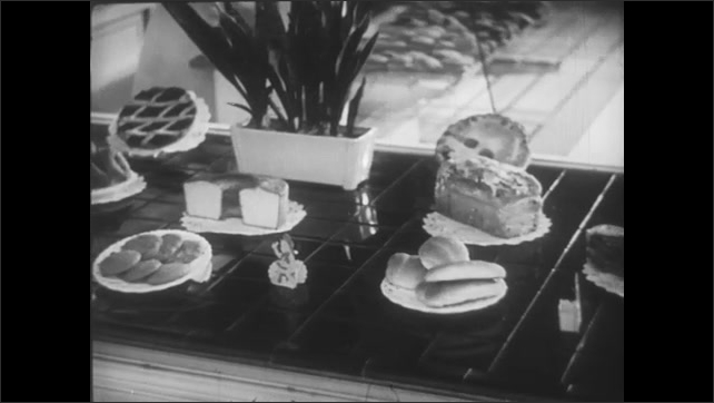 Different types of bread are displayed in a bakery.